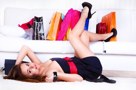 Young female customer in a dress lying on the floor. Stock Photo - 9476352
