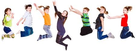 persona saltando: Siete ni�os alegres saltando, aislado Foto de archivo