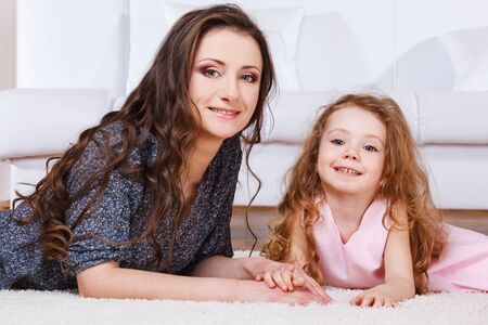 curly hair child: Lovely Mom and daughter
