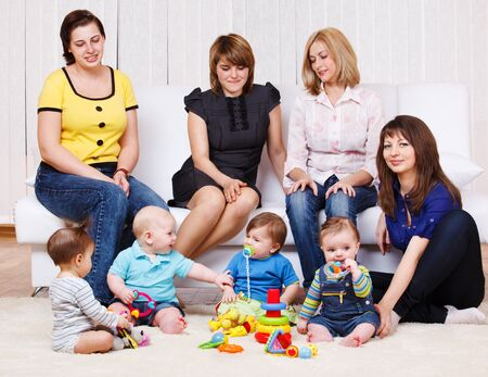 Several young women and their kids playing Stock Photo - 9587550