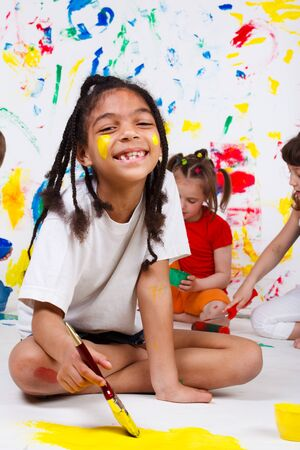 A cheerful African American girl painting  Stock Photo - 9587549