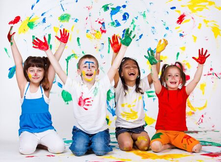 naughty boy: A group of cheerful kids with their palms and clothing painted