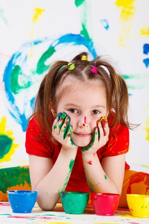 elementary age girls: Portrait of a beautful girl with face and hands painted