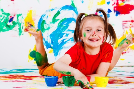 Little happy artist lying  Stock Photo - 9587572