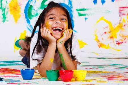 Excited girl painting Stock Photo - 9587580