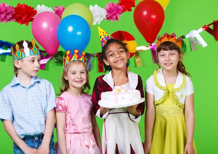 Cheerful children with the  birthday cake Stock Photo - 9589211