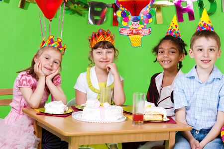 Sweet friends sitting at the table and eating  birthday cake Stock Photo - 9589202