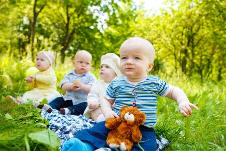 Four babies in the spring park photo