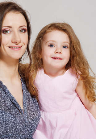 Portrait of beautiful mother and sweet little girl photo