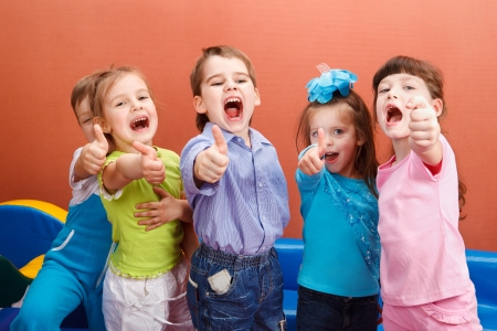 several: Group of cheerful children showing thumb up Stock Photo