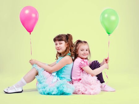 Two preschool girls with balloons in hand Stock Photo - 9589216