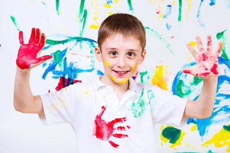 Laughing preschool boy, over painted background photo