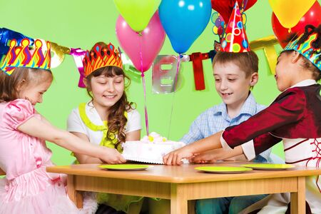 Laughing children fighting for the birthday cake Stock Photo - 9617923