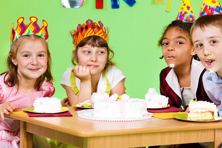 Cake eating contest at birthday party photo