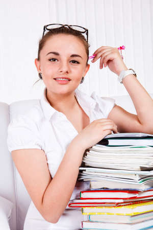 High school female student with books stack Stock Photo - 9670248