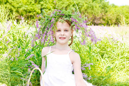 Portrait of a beautiful blond girl in the meadow photo
