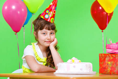 Pretty school aged girl in party cap Stock Photo - 9797671