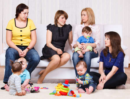 Women talking, their children playing Stock Photo - 9863751