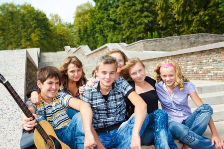 Group of smiling teen friends Stock Photo - 9978619