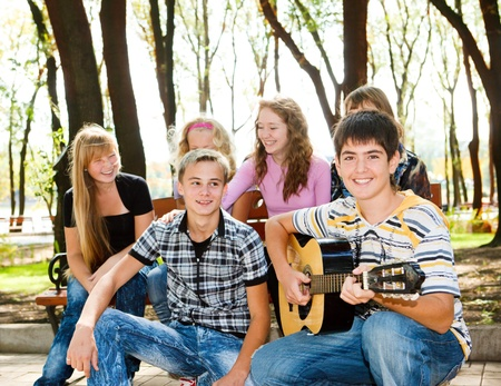 young youth: Teens crowd enjoying leisure in park