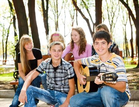 leisure time: Teens crowd enjoying leisure in park