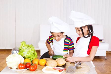 Boy and girl busy with cooking  photo
