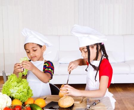 Lovely school aged siblings making sandwich photo