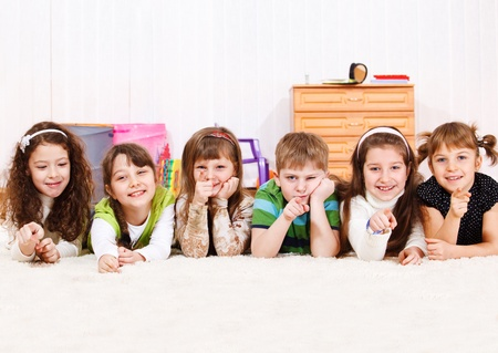 Group of lovely kids pointing finger photo