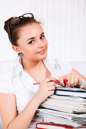 Portrait of a young woman with books on her knees Stock Photo - 10369676