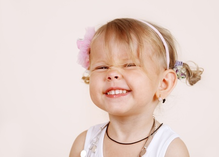 baby girls smiley face: Portrait of a cheerful laughing toddler girl Stock Photo
