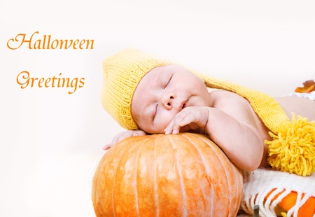 Portrait of an innocent Halloween baby in yellow hat  photo