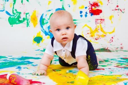 infant school: Curious toddler fingerpainting