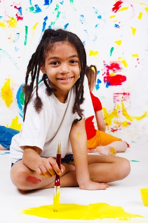 american children: African american junior student painting  Stock Photo