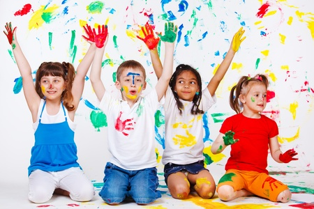Excited junior students with hands painted photo