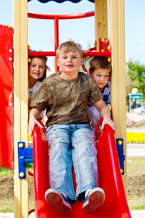 Three friends ready to slide down Stock Photo - 10427992
