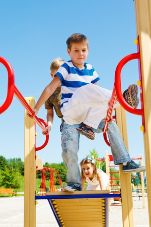 Kids having fun on the playground Stock Photo - 10427983
