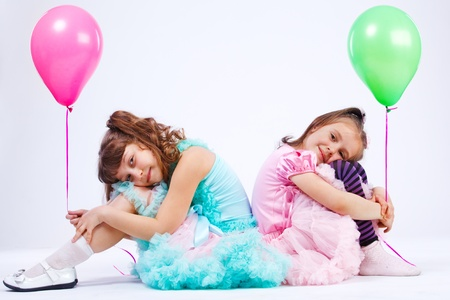 sibling: Two cute girls with balloons