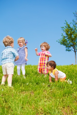 Group of four kids,  playing Stock Photo - 10427981