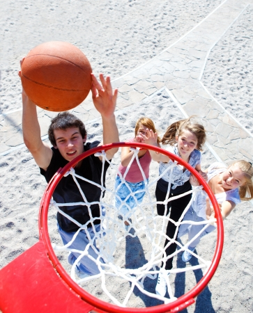 Teenagers playing outdoor basketball  photo