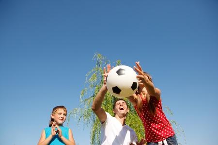 Dad and kids having summer fun  photo