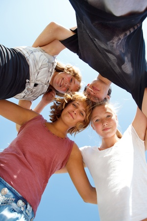 Group of happy teens making a circle Stock Photo - 10428040