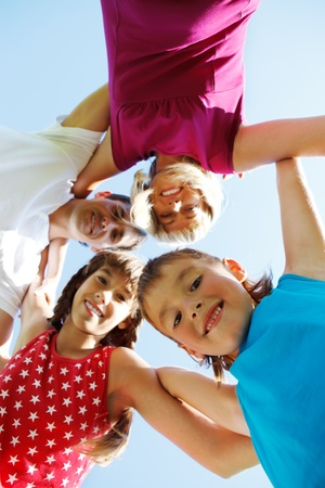 leisure time: Cheerful school aged boy and his family together Stock Photo