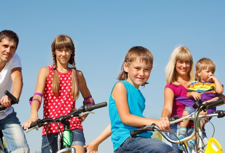 Portrait of family on  bicycles photo