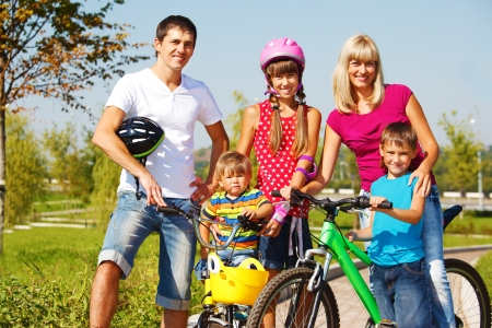 Happy active parents and their three kids photo