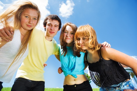 Three teenage girls and a guy embracing photo