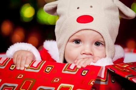 Christmas baby in a red present box photo