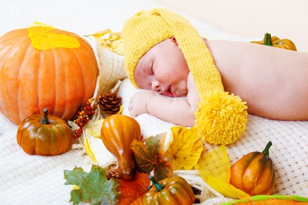 baby corn: Autumnal sleeping baby  Stock Photo