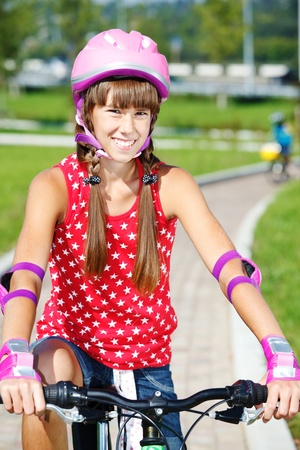 Teenage girl with  protective wear on, cycling Stock Photo - 10661667