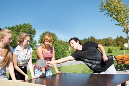 amateur: Amateur ping pong players having fun in the city park Stock Photo