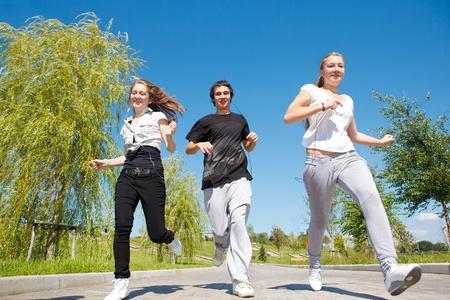 school sports: Highschool students running in park